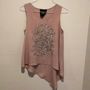 Blush handkerchief hem top with silver accent